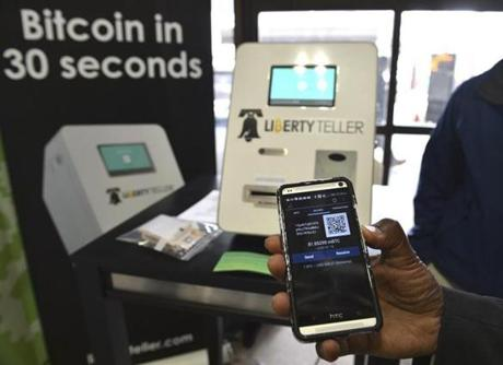 The Liberty Teller ATM at South Station began dispensing bitcoins to those who have a compatible app Wednesday.
